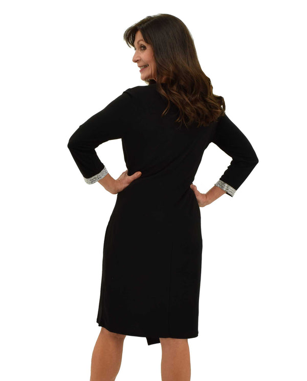 Back of Black 3/4 Sleeve Jewel Trim Dress with rhinestone cuffs and wrap style