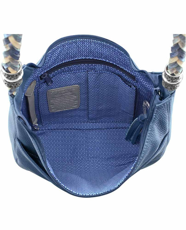 Interior of Brighton style H204BB Barbados Ziptop Hobo in Canyon Blue features a woven leather strap and a tassel zipper.