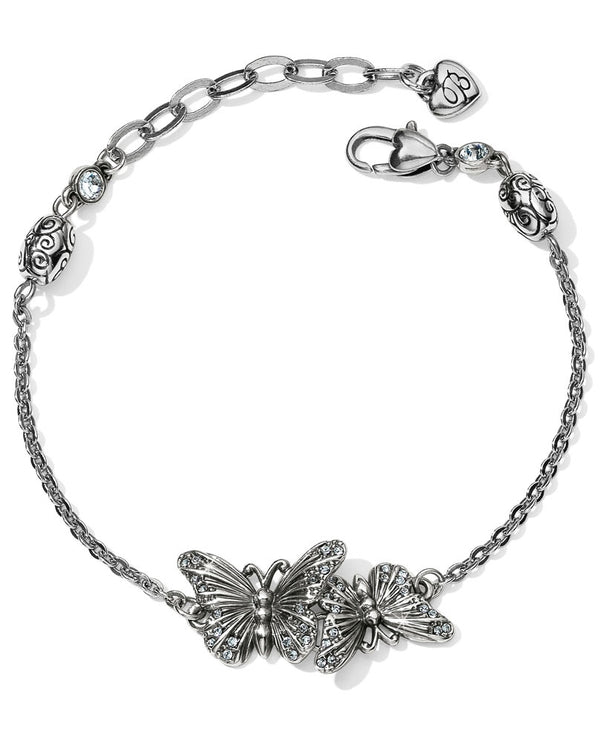 Intertwining butterflies grace this delicate link bracelet. Each wing is scattered with beautiful Swarovski crystal, that sparkle as you move.