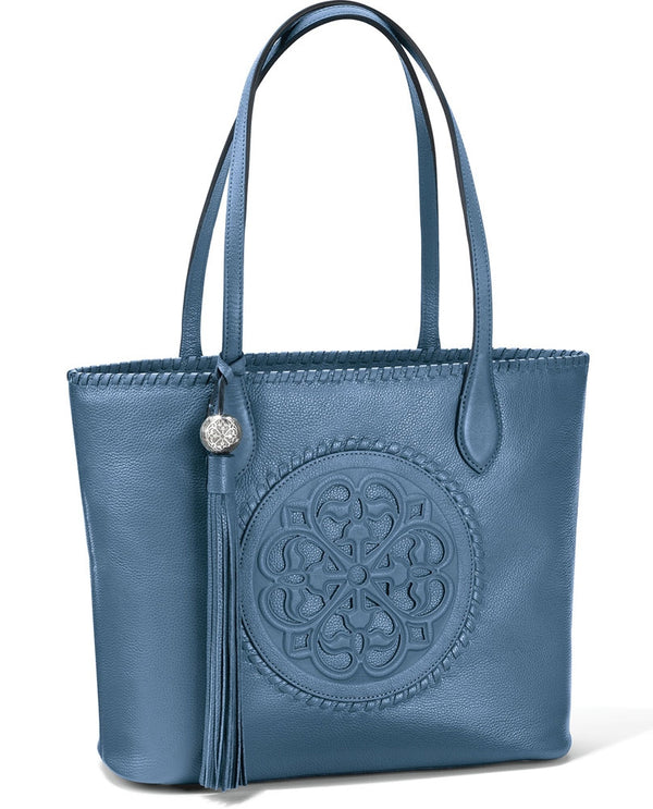 Brighton H3543B Gabriella Medallion Tote in Canyon Blue has art inspired by the rose windows of Europe's cathedrals and tassel
