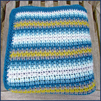 stripey crochet blanket folded
