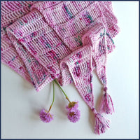 pink crochet shawl with flowers