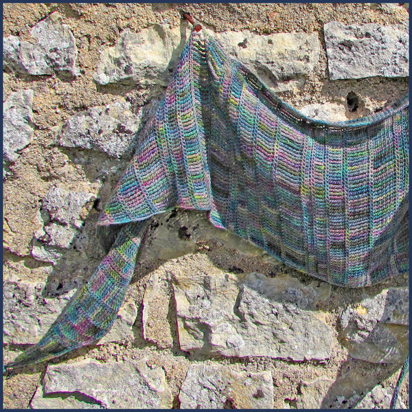 crochet scarf against a stone wall