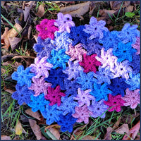 fragment of crochet blanket with join-as-you-go flower motif