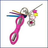 crochet travel kit with pink scissors and mini crochet hooks