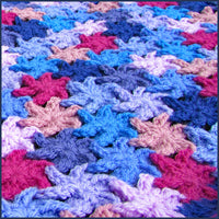 close up of a crochet flower blanket