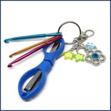 crochet travel kit with blue scissors and mini crochet hooks