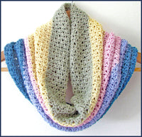 crochet cowl draped on a clothes hanger