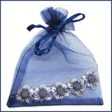 silver daisy chain shawl pin in blue organza bag