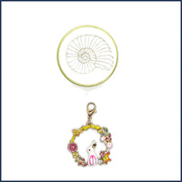 clip-on bunny stitch marker with gold ammonite tin