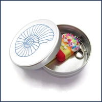ice lolly clip-on stitch marker in an aluminium tin