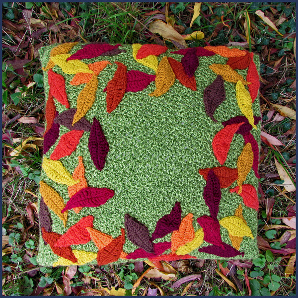 crochet cushion with leaf pattern on a lawn