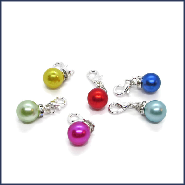six colourful Christmas ornament stitch markers