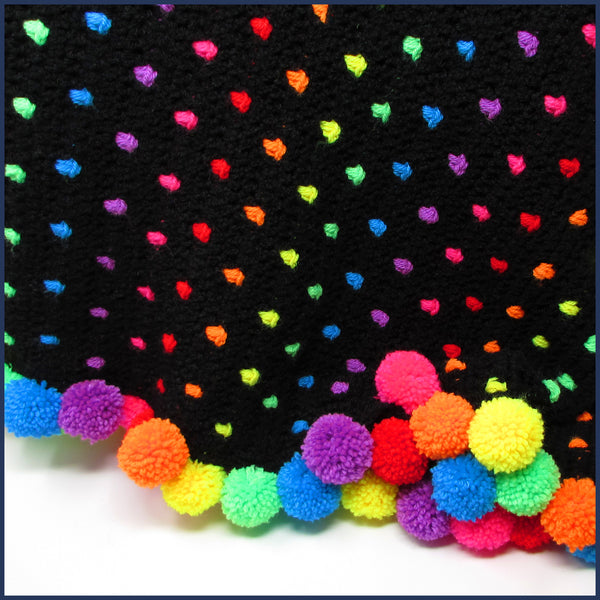 neon rainbow crochet blanket with pompoms