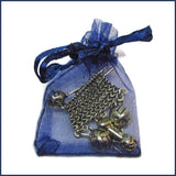 sweater knitting badge pin in a blue organza bag