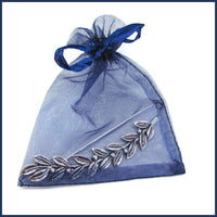 silver leaf and berries shawl pin in an organza bag