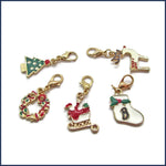 five Christmas stitch markers for crochet