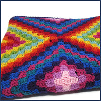 Mexican-inspired crochet blanket folded