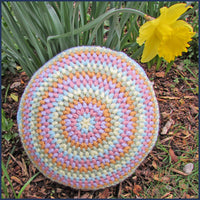 round crochet cushion with daffodil