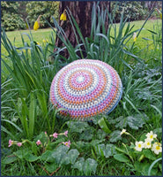 round crochet cushion in a flower border