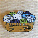 kitten in a basket of yarn badge pin on canvas