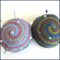 two crochet pin cushions