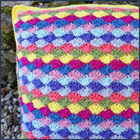 shell stitch crochet cushion