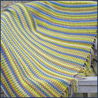 stripey crochet blanket on a garden chair
