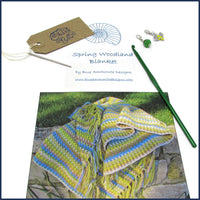 printed crochet pattern with hook and accessories