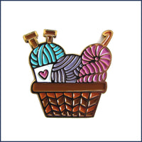 basket of knitting and crochet yarn pin badge