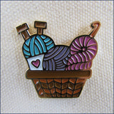 basket of knitting and crochet yarn pin badge on a canvas bag