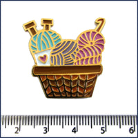 basket of knitting and crochet yarn pin badge with ruler