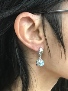 view of Concord Trillion sky blue topaz earring on Hannah Daye & Co