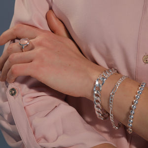 Stacked Bracelets including Bordillo Figaro and Beads shown with Sabine North South Rose Quartz Ring Hannah Daye & Co