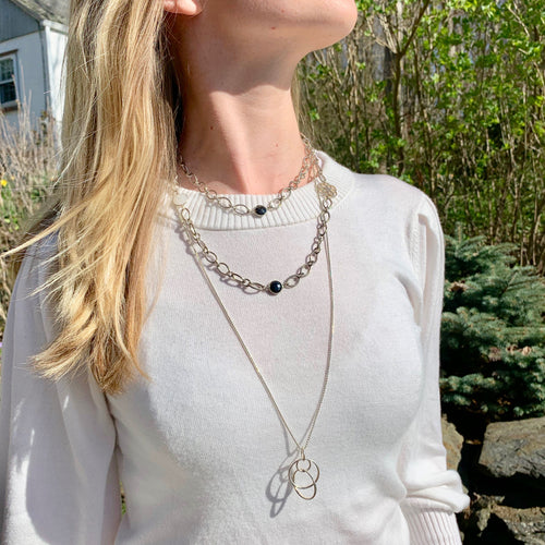 Saturn pendant layered with Cascade Infinity necklace Hannah Daye & Co