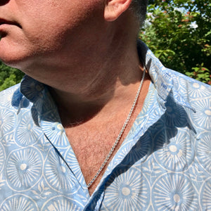 Venetian necklace on man with button-down shirt Hannah Daye & Co
