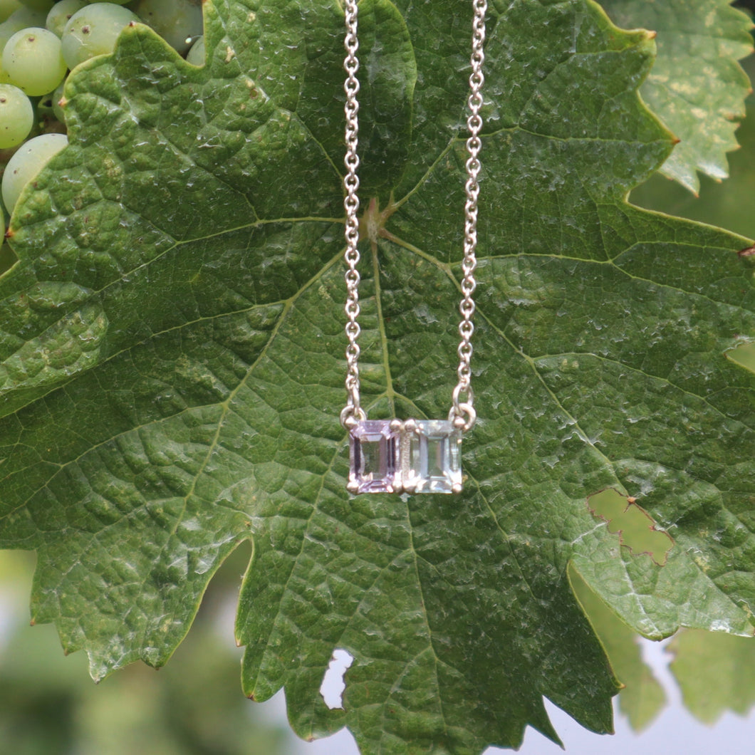 Lexington Necklace in Rose of France Amethyst and White Topaz shown with grape leaf by Hannah Daye & Co
