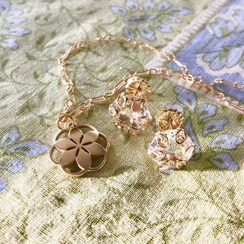 Rosette Mini Pendant in 14k yellow gold sown with Poppy earrings in White Topaz by Hannah Daye & Co
