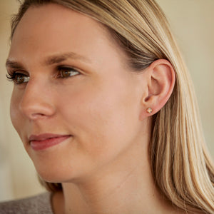 Opal Fiore Stud Earrings on model Hannah Daye & Co