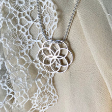 Load image into Gallery viewer, Rosette Plat Charm necklace on lace cloth Hannah Daye & Co