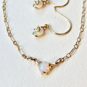 Fiore 14k gold necklace shown with drop earrings in Opal by Hannah Daye & Co