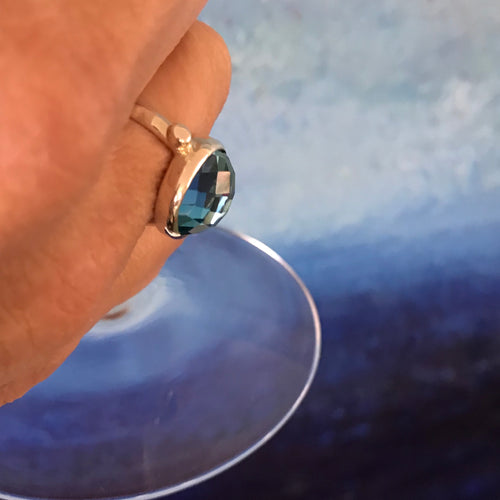 Sabine North South Swiss Blue topaz ring holding Martini Glass Hannah Daye & Co