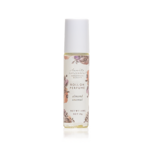 This image shows our Roll On Fragrance Oil.  It is an upclose view of the bottle on a white background.  The bottle is clear glass with a white cap.  There is a label with water colors beneath botanical floral drawings.  The label says Beaute Nouveau Botanical Beauty Roll On  Perfume the the scent and net weight of 10 ml 10g