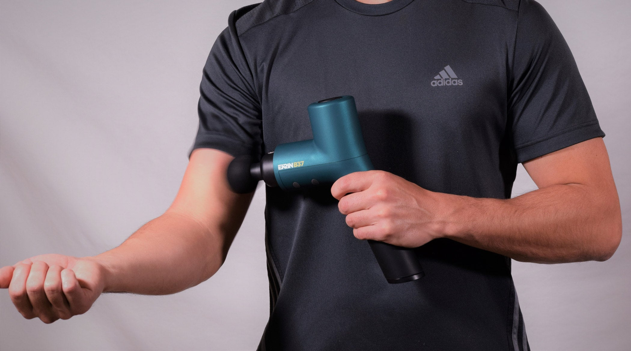 Ekrin B37 massage gun for arm muscle recovery after workout