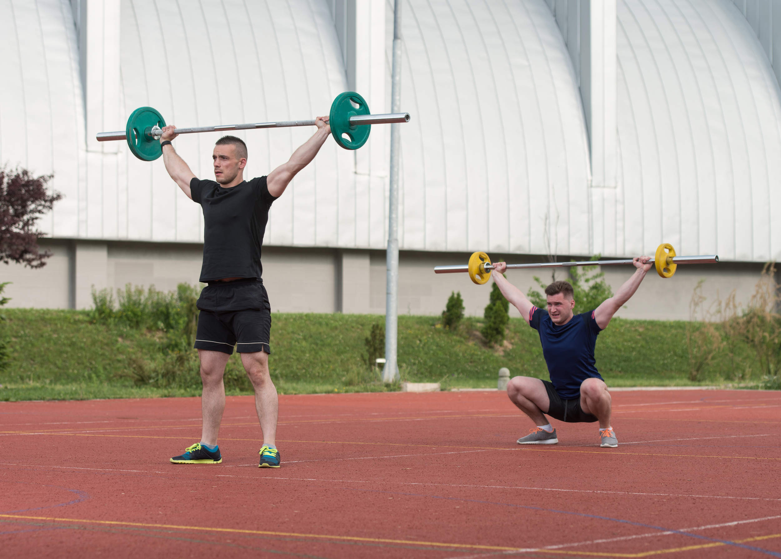 Olympic lifting outside on a track