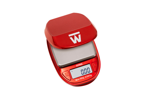 The new design of the Truweigh Sonic compact pocket scale in red. The cover is lifted to reveal the platform and digital screen.