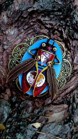 BROOCH SHE AND HE created by painter Marijus Piekuras