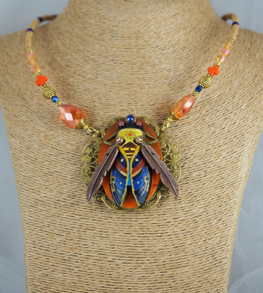 NECKLACE SOLAR BEETLE created by painter Marijus Piekuras
