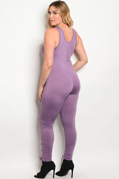 Plus size spandex blend jumpsuit with lace up details along the leg and a v neckline