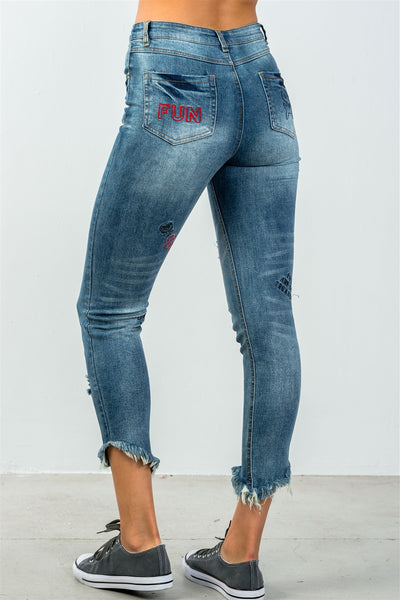 Ladies fashion denim distressed & graphic frayed hem skinny jeans